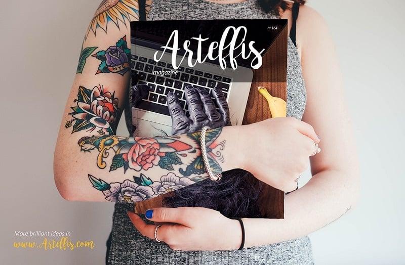 Free Magazine Mockup held by a tattooed woman