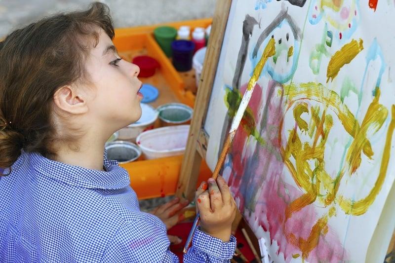 girl painting watercolors portrait