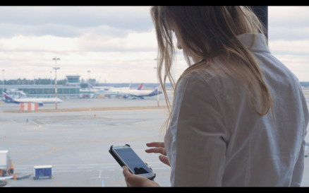 Woman texting and looking at airport - Stock Video