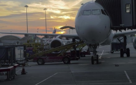 Timelapse of loading airplane at sunset vehicles - Stock Video