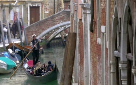 Gondolier Diverting a Gondola Boat with Tourists vehicles - Stock Video