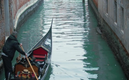 Veteran Gondolier Rowing Gondola along Water Canal in Venice, It vehicles - Stock Video