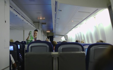 Stewardess giving drinks to passengers vehicles - Stock Video