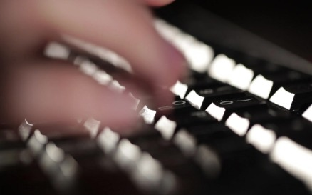 Woman is typing on the keyboard technology - Stock Video