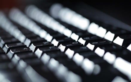 Typing on the keyboard at night technology - Stock Video