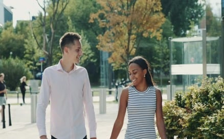 Multi-ethnic couple shyly looking at each other while - video footage Stock Video