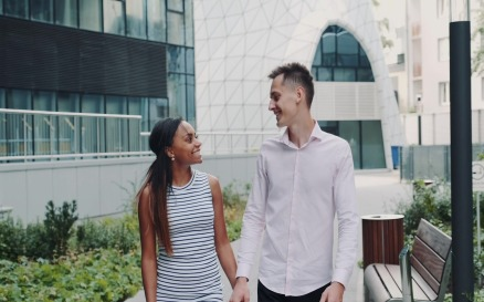 Happy multiracial couple having date in modern city - video footage Stock Video
