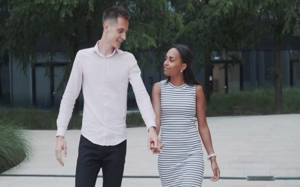 Cheerful multiethnic couple walking down the street - video footage Stock Video
