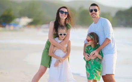 Family of Four Walking on White Beach Video Stock Video