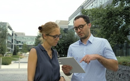 Business People Talking Outside With Electronic Stock Video