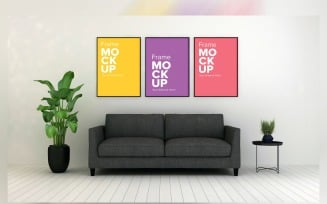 Gray Sofa In A Minimalistic Living Room With Three Frames On Walls Product Mockup