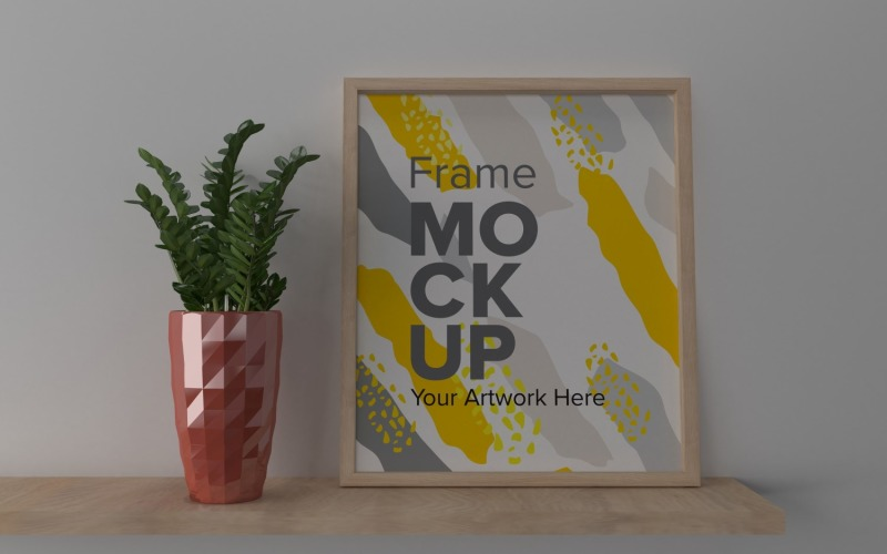 A Closeup Shot Of A Plant In A Vase Next To A Frame On A Gray Wall Mockup Template